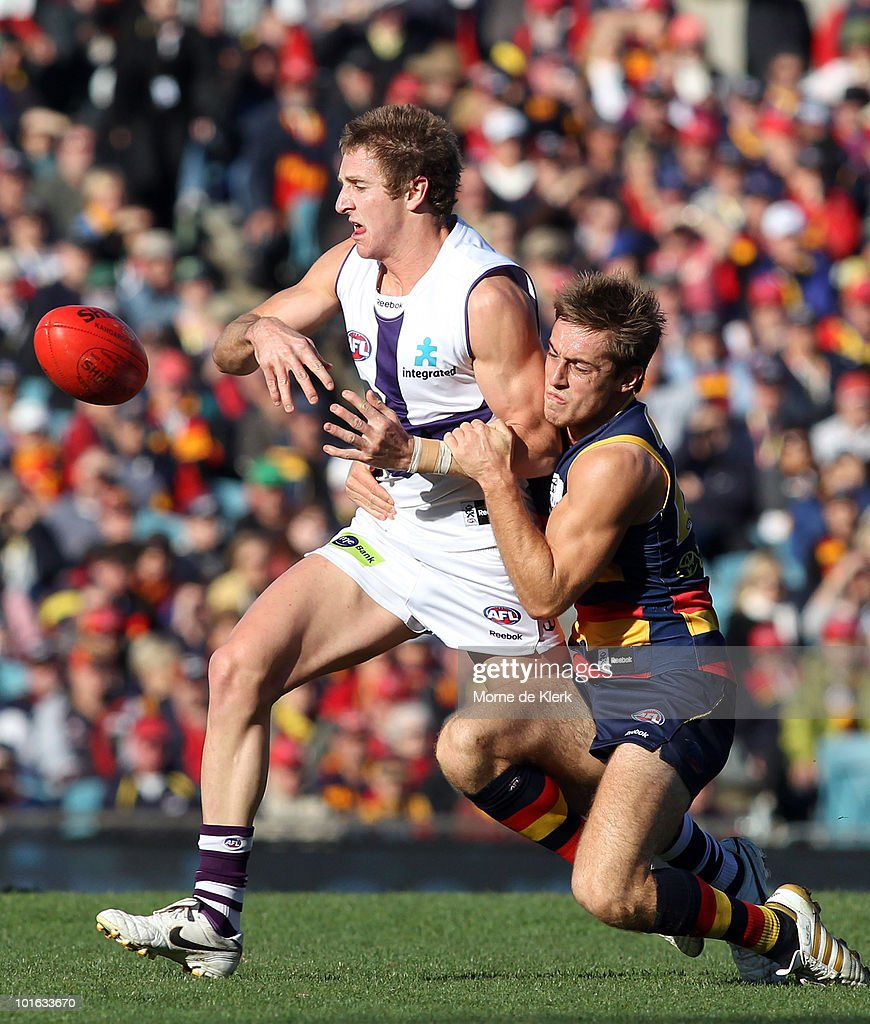 Richard Douglas of the Crows tackles Michael Barlow of the Dockers during the round 11 AFL match between the Adelaide Crows and the Fremantle Dockers at AAMI Stadium on June 5, 2010 in Adelaide, Australia.