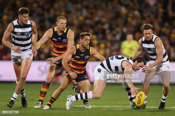 Richard Douglas of the Crows tackles Patrick Dangerfield of the Cats during the 2017 AFL round 18 match between the Adelaide Crows and the Geelong...