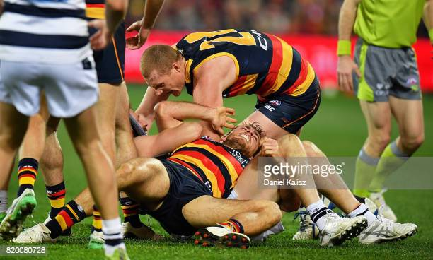 Richard Douglas of the Crows wrestles with Scott Selwood of the Cats during the round 18 AFL match between the Adelaide Crows and the Geelong Cats at...
