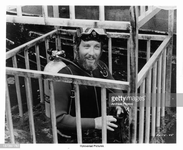 Richard Dreyfuss is lowered into the water in a diving cage in a scene from the film 'Jaws' 1975