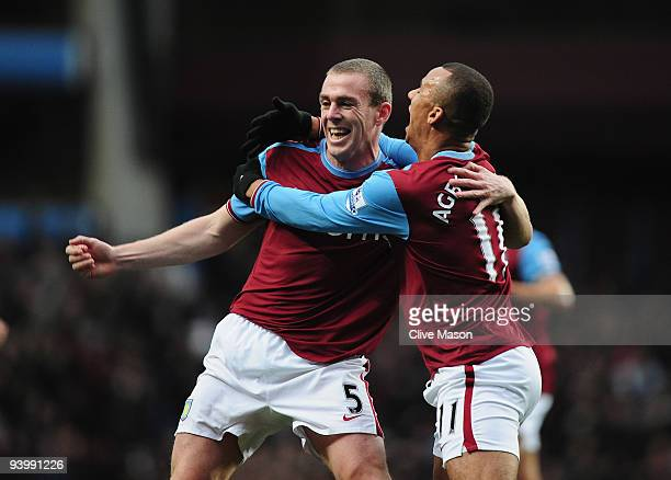 Richard Dunne and Gabriel Agbonlahor of Aston Villa celebrate after Richard Dunnes Gosl during the Barclays Premier League match between Aston Villa...