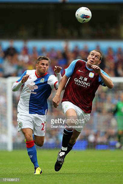 Richard Dunne of Aston Villa battle for the ball with David Goodwillie of Blackburn during the Barclays Premier League match between Aston Villa and...