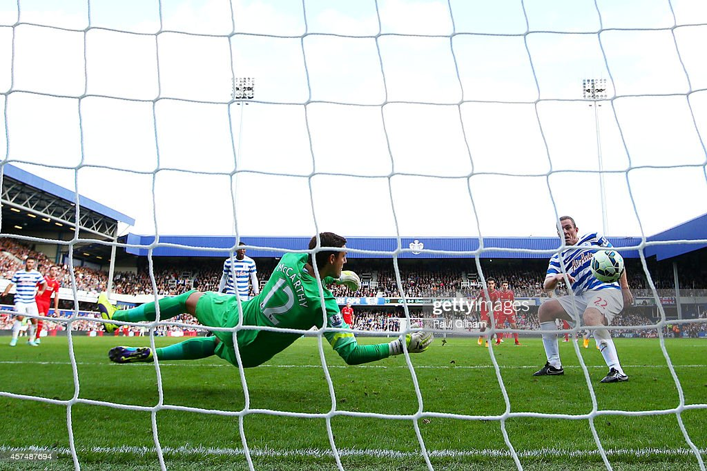 Richard Dunne of QPR scores an own goal past Alex McCarthy during the Barclays Premier League match between Queens Park Rangers and Liverpool at Loftus Road on October 19, 2014 in London, England.