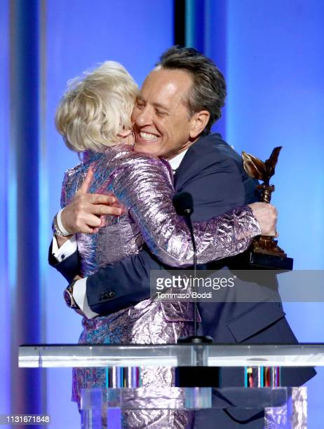 """Richard E Grant accepts Best Supporting Male for """"Can You Ever Forgive Me"""" from Glenn Close onstage during the 2019 Film Independent Spirit Awards on..."""