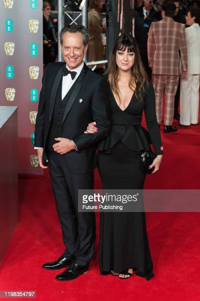 Richard E Grant and Olivia Grant attend the EE British Academy Film Awards ceremony at the Royal Albert Hall on 02 February 2020 in London England...