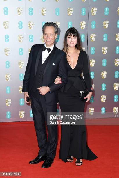 Richard E Grant and Olivia Grant attend the EE British Academy Film Awards 2020 at Royal Albert Hall on February 02 2020 in London England