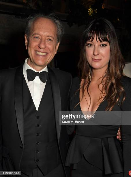 Richard E Grant and Olivia Grant pose the Netflix BAFTA after party at Chiltern Firehouse on February 2 2020 in London England