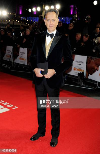 """Richard E. Grant attends the Royal Film Performance of """"Mandela: Long Walk to Freedom"""" at Odeon Leicester Square on December 5, 2013 in London,..."""