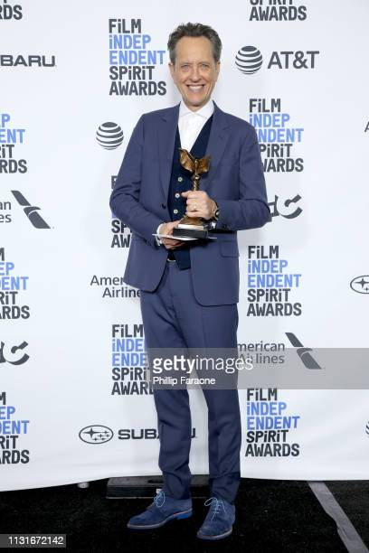 """Richard E Grant poses in the press room with the Best Supporting Male award for the film """"Can You Ever Forgive Me"""" during the 2019 Film Independent..."""