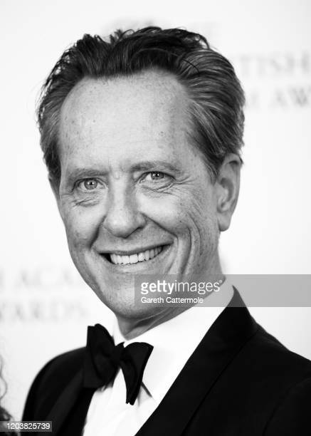 Richard E Grant poses in the Winners Room during the EE British Academy Film Awards 2020 at Royal Albert Hall on February 02 2020 in London England