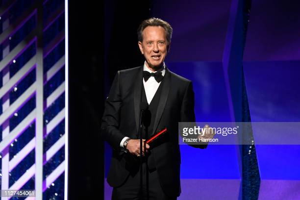 Richard E. Grant speaks onstage at the 18th Annual AARP The Magazine's Movies For Grownups Awards at the Beverly Wilshire Four Seasons Hotel on...