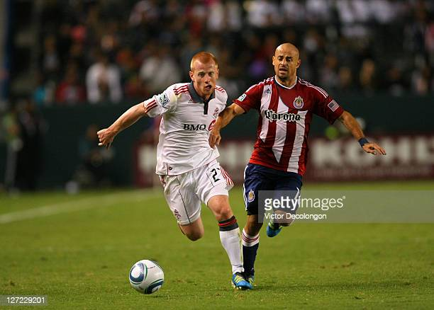 Richard Eckersley of Toronto FC and Laurent Courtois of Chivas USA pursue the ball during the MLS match at The Home Depot Center on September 24 2011...