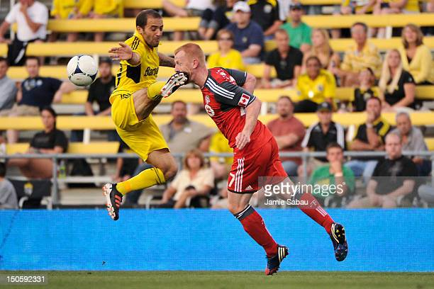 Richard Eckersley of Toronto FC is kicked in the face by Federico Higuain of the Columbus Crew as he heads the ball away in the first half on August...