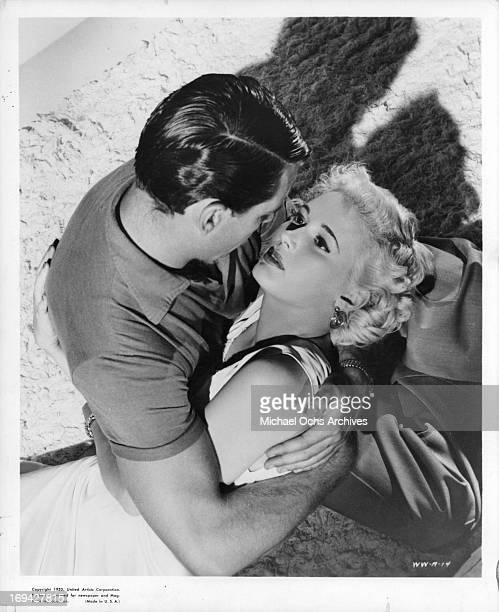 Richard Egan holding Beverly Michaels in a scene from the film 'Wicked Woman' 1953