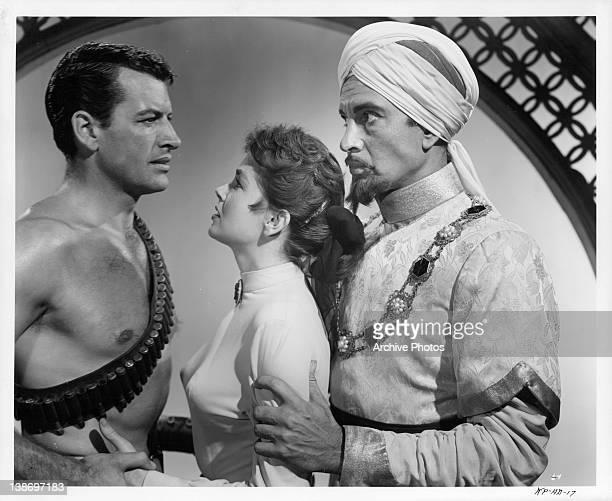 Richard Egan holding Dawn Adams' hand in a scene from the film 'Khyber Patrol' 1954
