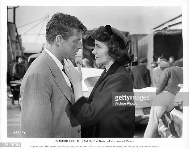 Richard Egan is comforted by Julie Adams in a scene from the film 'Slaughter On Tenth Avenue' 1957