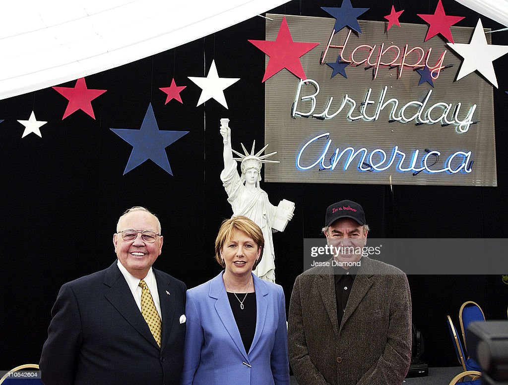 Richard Egan, US Ambassador to Ireland, President of Ireland Mary McAleese, and Neil Diamond at the entrance to the party tent for America's 226th birthday party in Ireland, taking place on July 4th.