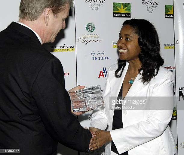 Richard Ellison editorinchief of New York Moves and Kathie Ann Joseph director of Breast Cancer Research at Columbia and honoree