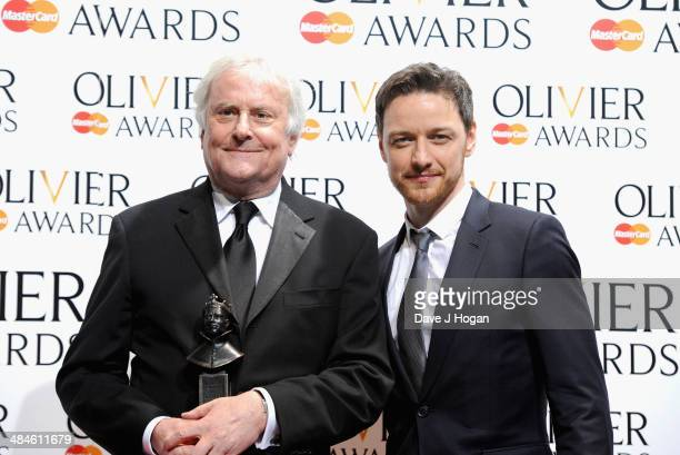 Richard Eyre with his Best Revival award for Ghosts with award presenter James McAvoy during the Laurence Olivier Awards at the Royal Opera House on...