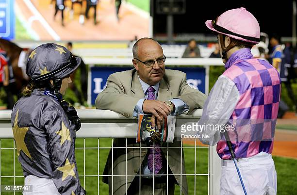Richard Fahey speaks to Hayley Turner and James Doyle prior during the first Longines Carnival Meeting at the Meydan Racecourse on January 9 2014 in...