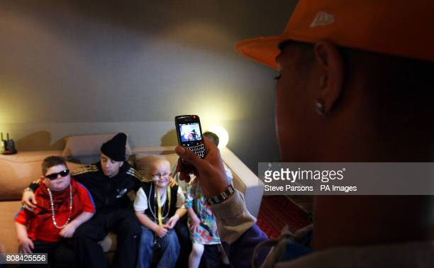 Richard 'Fazer' Rawson takes a picture of sixyearold Mark Sheppard from Glasgow and Sixyearold Mason Fountain from Ipswich with and Dino 'Dappy'...