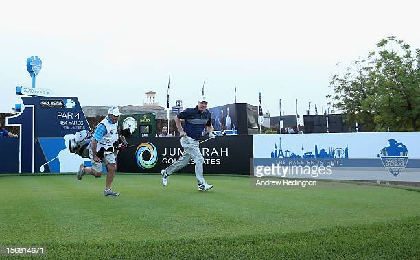 Richard Finch of England and his caddie Kyle Roadley run off of the first tee after the opening tee shot during the first round of the DP World Tour...