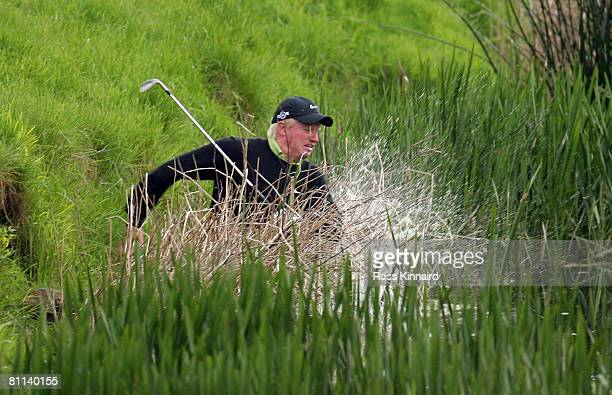 Richard Finch of England falls into the river Maigue after his second shot to the par five 18th hole during the final round of the Irish Open at...