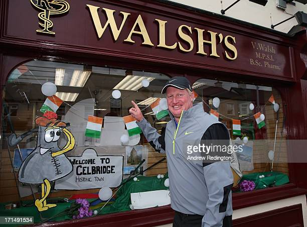 Richard Finch of England is pictured judging a shop front display in Celbridge as a preview to The Irish Open at Carton House Golf Club on June 25...