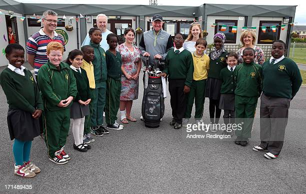 Richard Finch of England is pictured with pupils and teachers during a visit to Celbridge St Patrick's National School as a preview to The Irish Open...