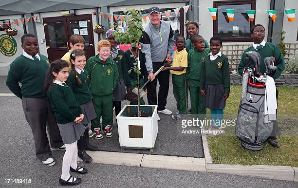 Richard Finch of England is pictured with pupils as he plants a commemorative tree during a visit to Celbridge St Patrick's National School as a...