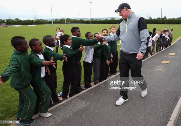 Richard Finch of England is welcomed by pupils during a visit to Celbridge St Patrick's National School as a preview to The Irish Open at Carton...