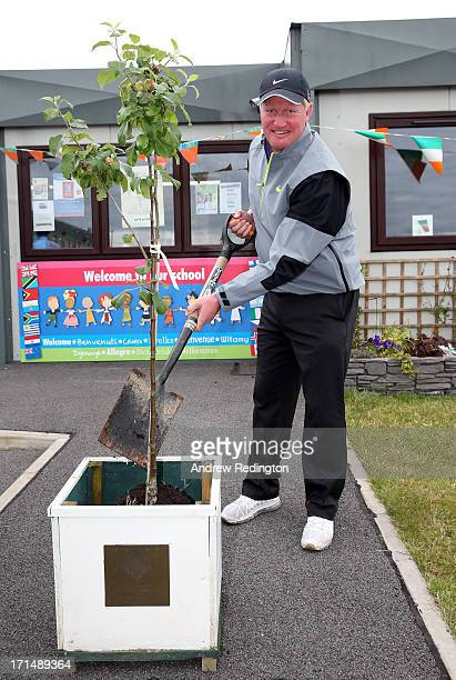 Richard Finch of England plants a commemorative tree during a visit to Celbridge St Patrick's National School as a preview to The Irish Open at...