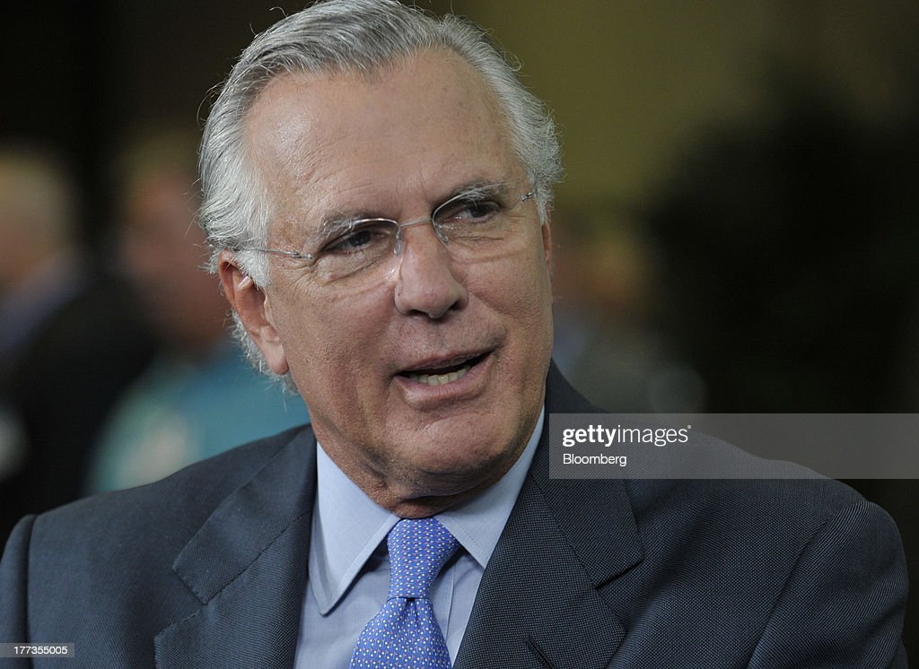 Richard Fisher, president of the Federal Reserve Bank of Dallas, speaks during an interview at the Wal-Mart Manufacturing Summit in Orlando, Florida, U.S., on Thursday, Aug. 22, 2013. Fisher, one of the most vocal critics of bond purchases by the central bank, said record Fed stimulus cant revive U.S. manufacturers from a two-year slump caused by ambiguity in regulation and fiscal policy. Photographer: Jim Stem/Bloomberg via Getty Images