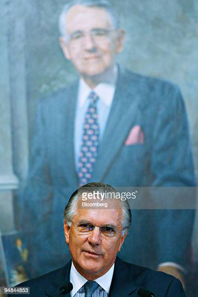 Richard Fisher president of the Federal Reserve Bank of Dallas speaks in front of a painted portrait of Peter Peterson senior chairman of The...