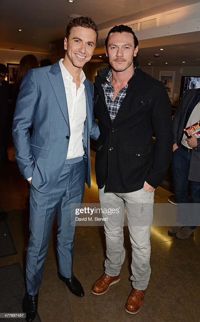Richard Fleeshman (L) and Luke Evans attend the press night performance of 'Urinetown' at the St James Theatre on March 11, 2014 in London, England.