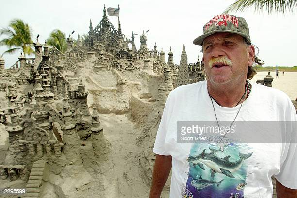 Richard Fontaine poses with a sand castle he helped build along the boardwalk March 13 2003 in Miami Beach Florida The giant sand castle took over...