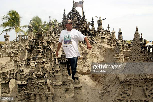 Richard Fontaine shows off a sand castle he helped build along the boardwalk March 13 2003 in Miami Beach Florida The giant sand castle took over 100...