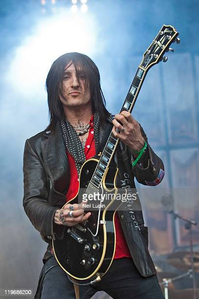 Richard Fortus of Thin Lizzy performs on the main stage on day one of the High Voltage Festival at Victoria Park on July 23 2011 in London United...