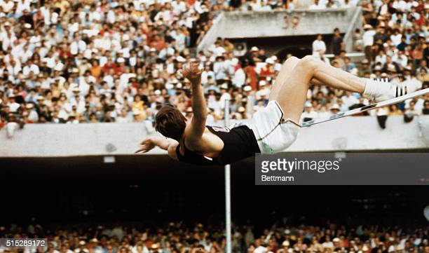 Richard Fosbury of the US in his unusual 'flipflop' style sets an Olympic record as he clears the bar in the high jump event at 7 feet 4 1/2 inches...