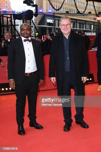 "Richard Fouofie Djimeli and Joachim Krol pose at the ""Berlin Alexanderplatz"" premiere during the 70th Berlinale International Film Festival Berlin at..."