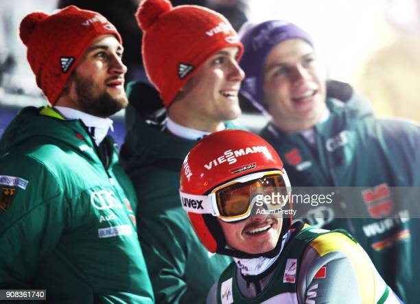 Richard Freitag of Germany and team mates Markus Eisenbichler Andreas Wellinger and Stephan Leyhe of Germany smile after their second competition...