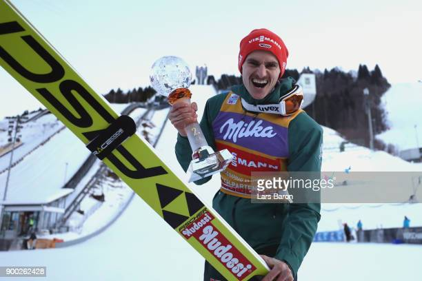 Richard Freitag of Germany celebrates winning the 2nd place on day 4 of the FIS Nordic World Cup Four Hills Tournament ski jumping event at...