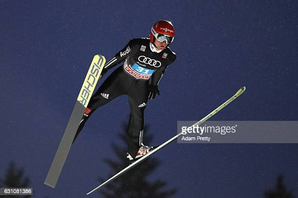 Richard Freitag of Germany competes at the first round on Day 2 of the 65th Four Hills Tournament ski jumping event at PaulAusserleitnerSchanze on...