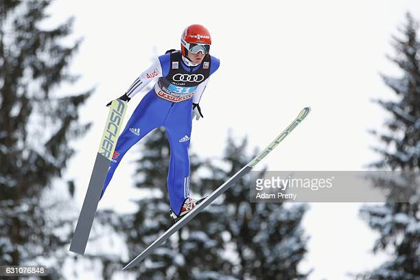 Richard Freitag of Germany competes at the trail round on Day 2 of the 65th Four Hills Tournament ski jumping event at PaulAusserleitnerSchanze on...