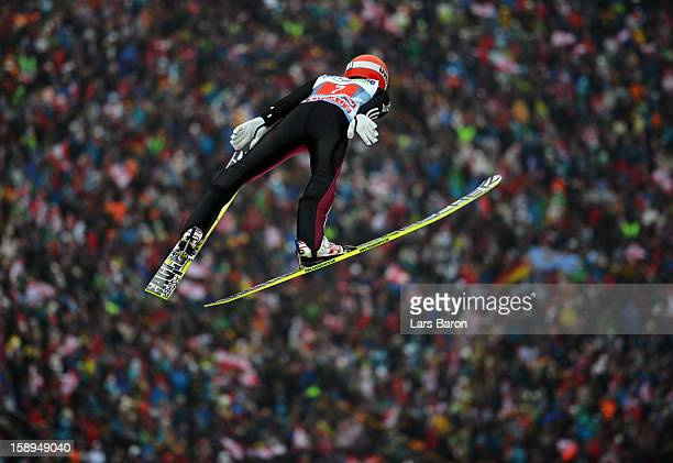 Richard Freitag of Germany competes during the first round for the FIS Ski Jumping World Cup event of the 61st Four Hills ski jumping tournament at...