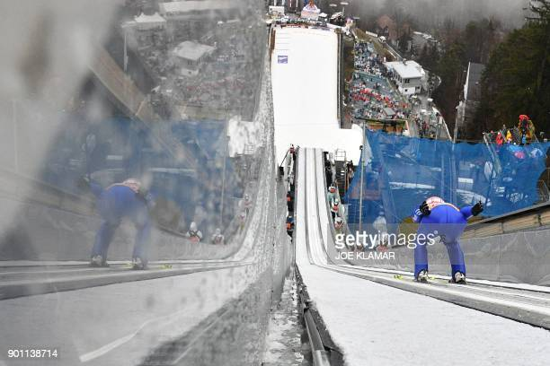 Richard Freitag of Germany jumps during the ski jumping training round of the third stage at the 66th Four Hills Tournament in Innsbruck Austria on...