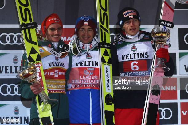 Richard Freitag of Germany Kamil Stoch of Poland and Dawid Kubacki of Poland on the podium after the FIS Nordic World Cup on day 2 of the Four Hills...