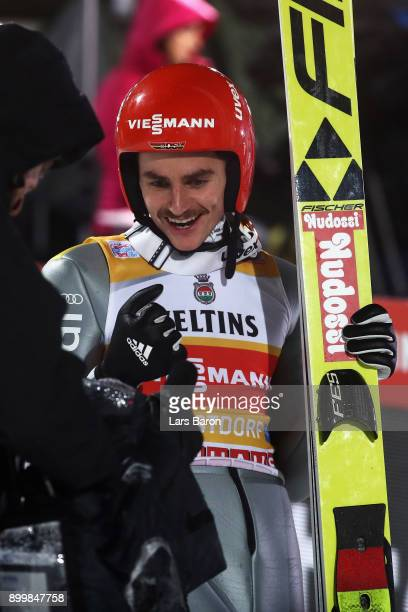 Richard Freitag of Germany reacts after he competes in the FIS Nordic World Cup on day 2 of the Four Hills Tournament ski jumping event on December...
