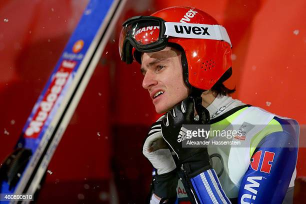Richard Freitag of Germany reacts after his first round jump on day 2 of the Four Hills Tournament Ski Jumping event at SchattenbergSchanze Erdinger...