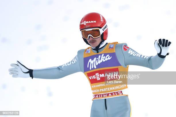 Richard Freitag of Germany reacts after the final round on day 4 of the FIS Nordic World Cup Four Hills Tournament ski jumping event at...